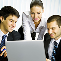 Description: Three happy smiling successful business people working with laptop at office Stock Photo - 12234699